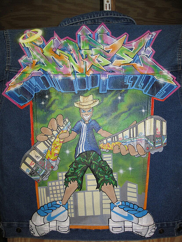 Street artist Kepos graffit art on a back on a jean jacket. 2010
