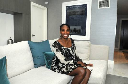 Venus poses inside the newly renovated InterContinental Miami Presidential Suite  designed by her firm, V Starr Interiors. The redesign is part of a larger $30M  renovation project of the entire hotel, including new interactive technology in the lobby and a  19-story LED Digital Canvas on the hotel's exterior façade.