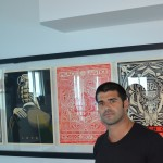 Alex Mijares next to his limited edition proof by Sheppard Fairey