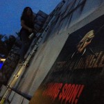 Artist Diana Contreras putting Finishing touches to Terror in the Jungle Haunted House